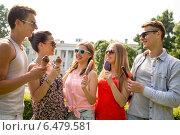 Купить «group of smiling friends with ice cream outdoors», фото № 6479581, снято 20 июля 2014 г. (c) Syda Productions / Фотобанк Лори