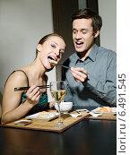Купить «Young couple eating japanese food.», фото № 6491545, снято 29 февраля 2020 г. (c) BE&W Photo / Фотобанк Лори