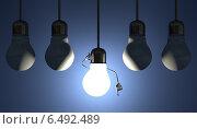 Купить «Светящийся персонаж лампочка в момент озарения висит в патроне на проводе среди выключенных лампочек на синем фоне», иллюстрация № 6492489 (c) Дмитрий Гужанин / Фотобанк Лори