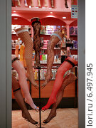 Купить «Display window of a stocking store, Poznan, Poland», фото № 6497945, снято 2 апреля 2006 г. (c) Caro Photoagency / Фотобанк Лори