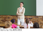 Купить «Cute pupils listening to their teacher in classroom», фото № 6499093, снято 11 мая 2014 г. (c) Wavebreak Media / Фотобанк Лори