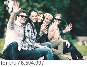 Купить «group of students or teenagers waving hands», фото № 6504997, снято 15 сентября 2013 г. (c) Syda Productions / Фотобанк Лори