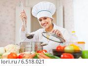Купить «Happy beautiful cook works with ladle», фото № 6518021, снято 2 февраля 2013 г. (c) Яков Филимонов / Фотобанк Лори
