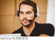 Купить «Businessman using headset in distribution warehouse», фото № 6545673, снято 10 мая 2014 г. (c) Wavebreak Media / Фотобанк Лори