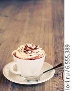 Чашка капучино на столе. Стоковое фото, фотограф Светлана Витковская / Фотобанк Лори