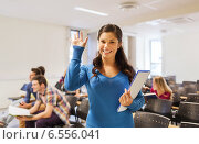 Купить «group of smiling students in lecture hall», фото № 6556041, снято 7 сентября 2014 г. (c) Syda Productions / Фотобанк Лори