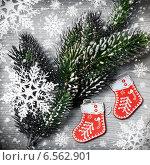 Купить «Еловая ветка с игрушками-сапожками», фото № 6562901, снято 2 января 2014 г. (c) ElenArt / Фотобанк Лори