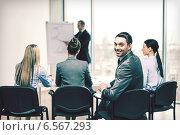 Купить «businessman with team in office», фото № 6567293, снято 9 ноября 2013 г. (c) Syda Productions / Фотобанк Лори