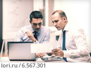 Купить «two businessmen having discussion in office», фото № 6567301, снято 9 ноября 2013 г. (c) Syda Productions / Фотобанк Лори