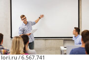 Купить «group of students and teacher in classroom», фото № 6567741, снято 7 сентября 2014 г. (c) Syda Productions / Фотобанк Лори