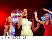 Купить «three smiling women dancing and singing karaoke», фото № 6575129, снято 20 октября 2013 г. (c) Syda Productions / Фотобанк Лори