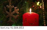 Купить «Новогоднее украшение - свеча и деревянная снежинка», видеоролик № 6584853, снято 24 октября 2014 г. (c) Михаил Коханчиков / Фотобанк Лори