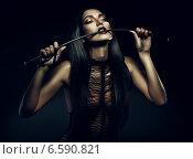 woman biting whip. Стоковое фото, фотограф Александр Буц / Фотобанк Лори