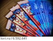Купить «Деньги Казахстана, банкноты тенге», фото № 6592641, снято 7 августа 2013 г. (c) ElenArt / Фотобанк Лори