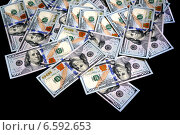 Купить «Американские доллары на чёрном фоне», фото № 6592653, снято 7 августа 2013 г. (c) ElenArt / Фотобанк Лори
