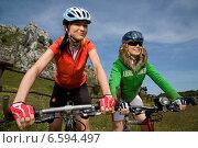 Купить «Two women cycling», фото № 6594497, снято 10 июня 2020 г. (c) BE&W Photo / Фотобанк Лори