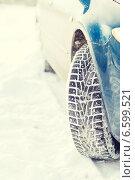 Купить «closeup of car winter tire», фото № 6599521, снято 16 января 2014 г. (c) Syda Productions / Фотобанк Лори