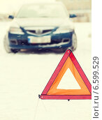 Купить «closeup of warning triangle and car», фото № 6599529, снято 16 января 2014 г. (c) Syda Productions / Фотобанк Лори