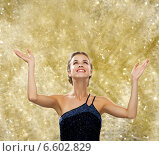 Купить «smiling woman raising hands and looking up», фото № 6602829, снято 1 июня 2014 г. (c) Syda Productions / Фотобанк Лори