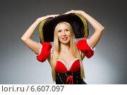 Woman pirate against grey background. Стоковое фото, фотограф Elnur / Фотобанк Лори