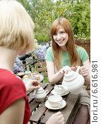 Купить «Two girls drinking using porcelain tableware.», фото № 6616981, снято 7 декабря 2019 г. (c) BE&W Photo / Фотобанк Лори