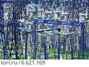 Купить «Оборудование высоковольтной электрической подстанции с ночной подсветкой», фото № 6621169, снято 18 мая 2012 г. (c) yeti / Фотобанк Лори