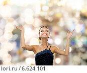 Купить «smiling woman raising hands and looking up», фото № 6624101, снято 1 июня 2014 г. (c) Syda Productions / Фотобанк Лори