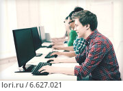 Купить «student with computer studying at school», фото № 6627021, снято 16 июня 2013 г. (c) Syda Productions / Фотобанк Лори