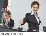 Hotel worker on reception. Стоковое фото, фотограф Дмитрий Калиновский / Фотобанк Лори