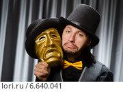 Купить «Funny concept with theatrical mask», фото № 6640041, снято 8 июля 2014 г. (c) Elnur / Фотобанк Лори