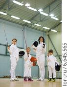 Купить «Children fencers and their trainer», фото № 6645565, снято 26 октября 2014 г. (c) Andrejs Pidjass / Фотобанк Лори