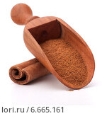 Купить «ground cinnamon spice powder in wooden spoon isolated on white background cutout», фото № 6665161, снято 18 апреля 2013 г. (c) Natalja Stotika / Фотобанк Лори