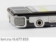 Купить «Современный диктофон на столе», эксклюзивное фото № 6677833, снято 16 ноября 2014 г. (c) Юрий Шурчков / Фотобанк Лори