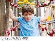 Excited girl developing dexterity. Стоковое фото, фотограф Яков Филимонов / Фотобанк Лори
