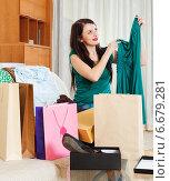 Купить «Happy brunette woman looking new dress», фото № 6679281, снято 21 апреля 2019 г. (c) Яков Филимонов / Фотобанк Лори
