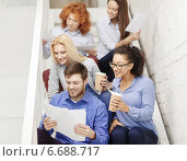 Купить «team with papers and take away coffee on staircase», фото № 6688717, снято 1 февраля 2014 г. (c) Syda Productions / Фотобанк Лори