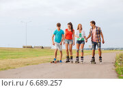 Купить «group of smiling teenagers with roller-skates», фото № 6689257, снято 10 августа 2014 г. (c) Syda Productions / Фотобанк Лори