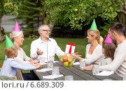 Купить «happy family having holiday dinner outdoors», фото № 6689309, снято 21 августа 2014 г. (c) Syda Productions / Фотобанк Лори