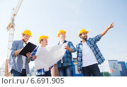 Купить «group of builders with tablet pc and blueprint», фото № 6691905, снято 21 сентября 2014 г. (c) Syda Productions / Фотобанк Лори