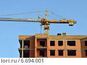Купить «Строительство дома», фото № 6694001, снято 21 января 2014 г. (c) Сергей Трофименко / Фотобанк Лори