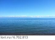 Озеро Иссык-Куль и горы Терскей Алатау. Стоковое фото, фотограф Анатолий Хвисюк / Фотобанк Лори