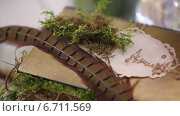 Купить «Книга с цветами и перо птицы», видеоролик № 6711569, снято 21 ноября 2014 г. (c) Потийко Сергей / Фотобанк Лори