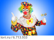 Купить «Clown with lollipops isolated on white», фото № 6713933, снято 26 июня 2013 г. (c) Elnur / Фотобанк Лори