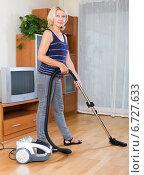 Купить «woman cleaning with vacuum cleaner», фото № 6727633, снято 15 февраля 2019 г. (c) Яков Филимонов / Фотобанк Лори