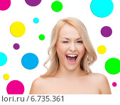 Купить «beautiful young woman over polka dot background», фото № 6735361, снято 7 января 2014 г. (c) Syda Productions / Фотобанк Лори