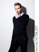Купить «Fashion portrait of young man in black pullover.», фото № 6736277, снято 9 февраля 2014 г. (c) Валуа Виталий / Фотобанк Лори