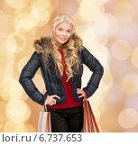 Купить «smiling young woman with shopping bags», фото № 6737653, снято 13 ноября 2010 г. (c) Syda Productions / Фотобанк Лори