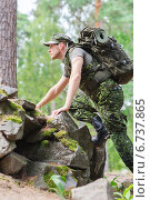 Купить «young soldier with backpack in forest», фото № 6737865, снято 14 августа 2014 г. (c) Syda Productions / Фотобанк Лори