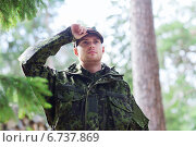 Купить «young soldier or ranger in forest», фото № 6737869, снято 14 августа 2014 г. (c) Syda Productions / Фотобанк Лори