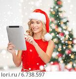 Купить «woman in santa helper hat with tablet pc», фото № 6738597, снято 27 сентября 2013 г. (c) Syda Productions / Фотобанк Лори